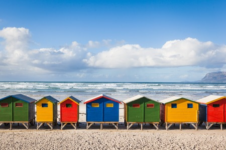 Row of brightly colored huts in Muizenberg beach. Muizenberg, Cape Town. South Africa