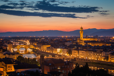 Florence after sunset from Michelangelo square: Palazzo Vecchio, Arno River, Ponte Vecchio, beautiful sky, hills in distance