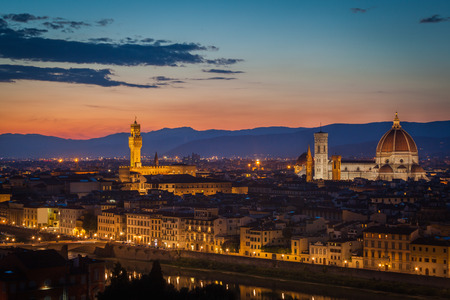 Florence after sunset from Michelangelo square: Palazzo Vecchio, Arno River, church of Santa Maria Novella, beautiful sky, hills in distance