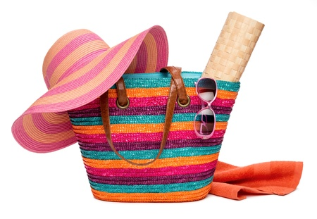 straw mat: Colorful striped beach bag with a straw hat sun mat towel and sunglasses, isolated on white