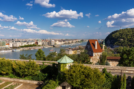 buda: Panorama of Budapest with the Elizabeth Bridge, Danube and the Gellert hill in a clear sunny weather with puffy clouds, Hungary Stock Photo
