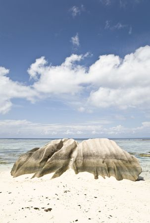 Eroded rock on the beach, La Digue, Republic of Seychelles, Indian Ocean Stock Photo