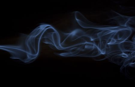 Waves of silky blue smoke on black background