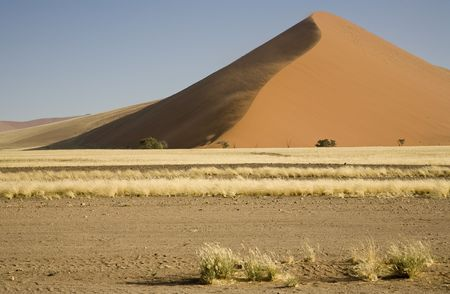 Strong wind is shaping a big dune, Namib Desert, Namib-Naukluft National Park, Republic of Namibia, Southern Africa