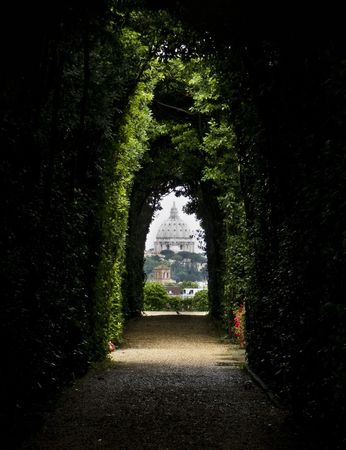 The dome of Saint Peters Basilica seen through the famous keyhole at the Villa Malta. Rome, Italy, Southern Europe