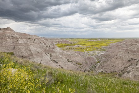 badlands: Badlands Wilderness with upcoming thunderstorm, Badlands National Park, South Dakota, United States Stock Photo