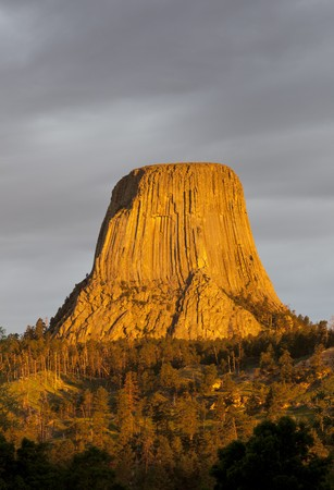 Devils Tower with a golden glow in the first sunlight, Devils Tower National Monument, Crook County, Wyoming, USA Stock Photo