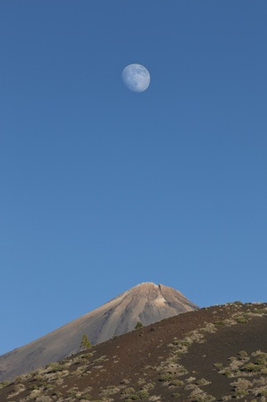 Moon over Mount Teide or, in Spanish, Pico del Teide, the third largest volcano on earth from its base, Tenerife, Canary Islands, Spain