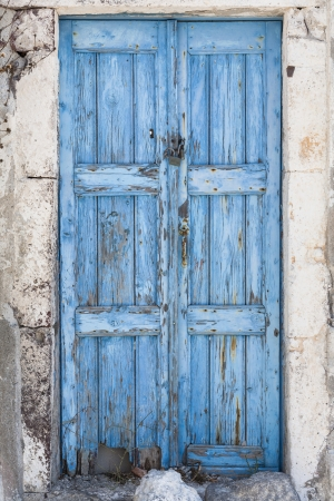 A weathered blue door on the island of Santorini, Greece, Europe Stock Photo