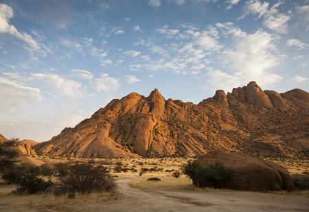 The granite peaks of Spitzkoppe at sunrise, Spitzkoppe, Namib desert, Namibia, southern Africa Stock Photo