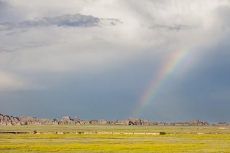 Rainbow and storm clouds over Badlands National Park, South Dakota, USA