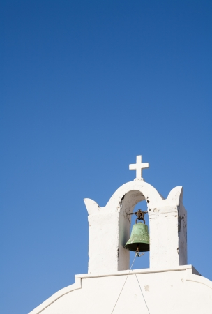 The bell tower of a church on the island of Santorini with a lot of copy space, Cyclades, Greece, Europe