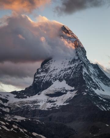 The Matterhorn with clouds at dusk, Pennine Alps, Valais, Switzerland, Europe
