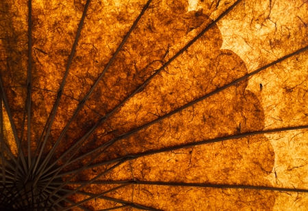 Part of a handmade umbrella, the sunlight shines through the paper and shows the beautiful warm colors, Myanmar, Southeast Asia Stock Photo