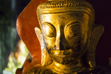 Close-up of a golden Buddha in the famous Pindaya Cave, shallow depth of field, Myanmar, Southeast Asia