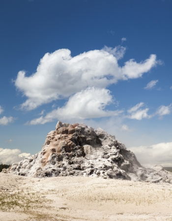 White Dome Geyser with clouds, Yellowstone National Park, Wyoming, USA
