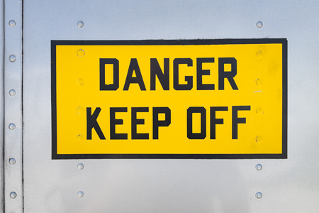 Danger Keep Off, yellow warning sign on the fuselage of a helicopter, USA