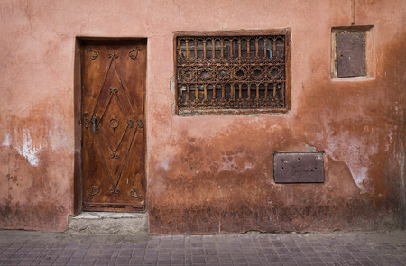 A door an a window in the Medina of Marrakesh, Morocco, North Africa
