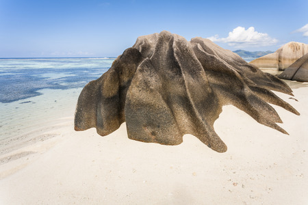 Granite rock formation on a white sandy beach on the island of La Digue, Seychelles, Indian Ocean Stock Photo