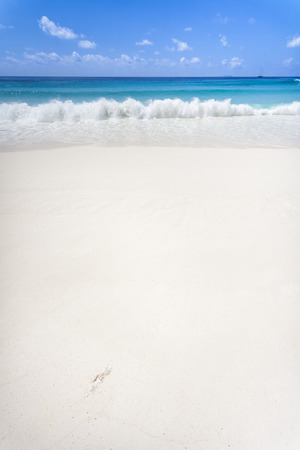 A white sandy beach with a lot of copy space. La Digue, Seychelles, Indian Ocean Stock Photo