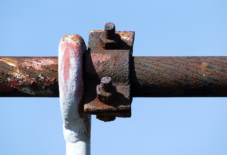 steel cable: rusty steel cable of bridge pylon with a hanger, and clip Stock Photo