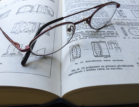 glasses left on a book after reading Stock Photo