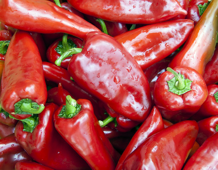 a pile of organic red peppers ready to making ajvar