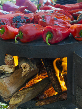 red peppers roasting on wood burning stove to making ajvar