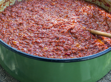 Homemade process of making delicious traditional Serbian food - ajvar Stock Photo