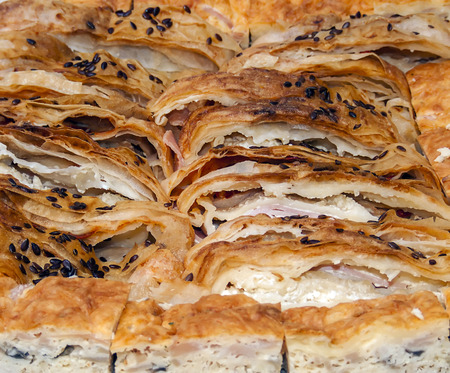 Pie with bacon and white cheese sliced and ready for serving Stock Photo