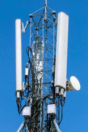 Communications antenna - cell phone tower against blue sky