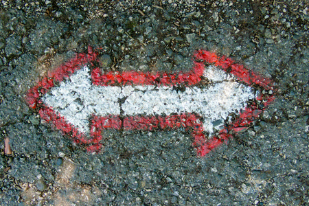 arrows on the asphalt for the orientation of the walker while walking along the path Stock Photo