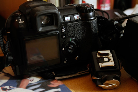 digital camera- back wiev, and various pieces of equipment on the table