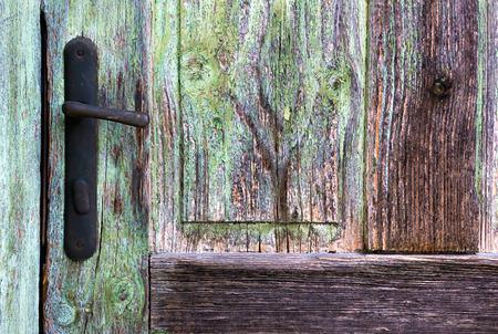 Closeup of an old wooden door with handle