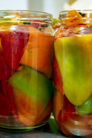 file pepper in jar, preparation and canning, ready to close lid - home made