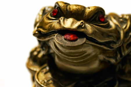 Chinese frog with coins, a symbol of money and wealth, close up, shallow of depth, soft focus Stock Photo
