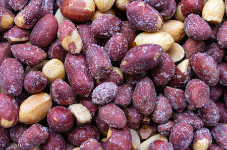 Roasted salted peanuts background. top view. Stock Photo