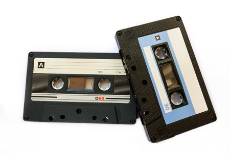 two black compact cassette with blank coloured labels