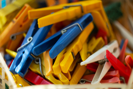 a bunch of used colorful plastic laundry clips, shallow depth