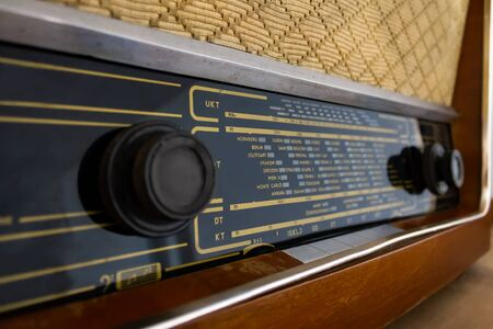 old radio from the 60s, in a wooden box with traces of use and past time Stock Photo