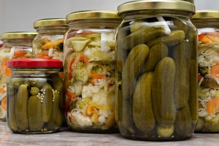 Winter stores, vegetables in jars - mixed salad of various vegetables and pickles