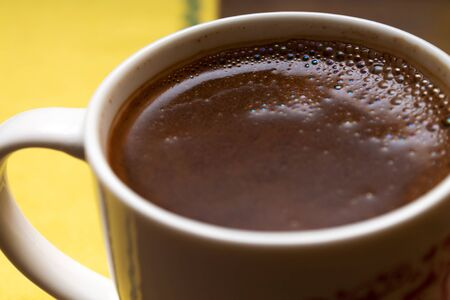 a cup of strong traditional coffee, also known as Turkish or Greek, with a strong foam on top