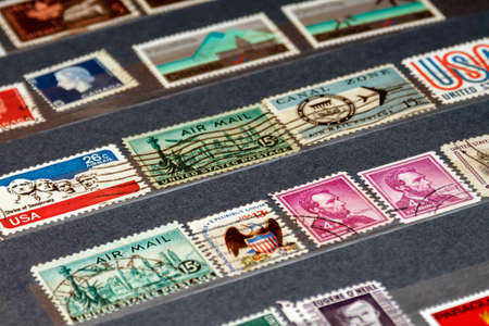 various old postage stamps from usa in the philatelic album Stock fotó