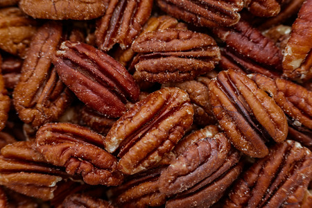 A pile of pecans fill the entire frame