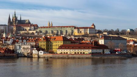 Skyline of Prague as seen across the Vltava river from Charles Bridge on a bright winter morning