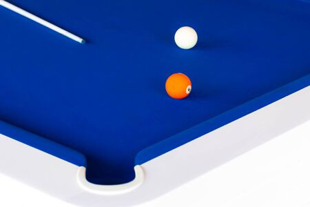 A bold blue pool table with balls and cue