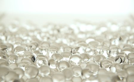 many white gel marbles on white background photo