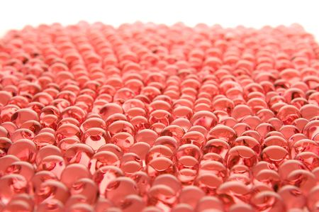 many red gel marbles on white background photo