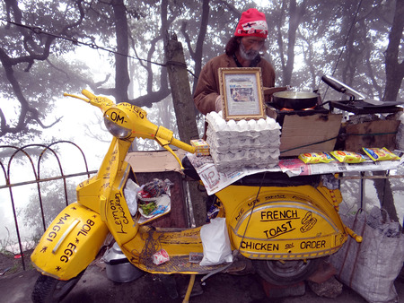 two wheeler: Mobile fast food shop on a two wheelerscooter Editorial