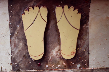hindu temple: Divine sandals of a Hindu deity in an old Hindu temple. Stock Photo
